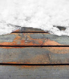 Partly snow covered wooden boards Royalty Free Stock Image