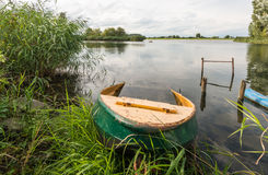Partly sunken iron rowboat Stock Image