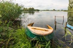 Partly sunken iron rowboat Stock Image
