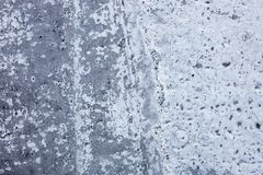 Partly whitewashed concrete wall with rich and various texture Stock Photos
