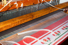 Partly woven carpet, rug on a loom shows wool pile, foundation Royalty Free Stock Images