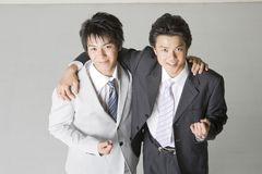 Partner. Two young Japanese businessmen united each other Royalty Free Stock Images