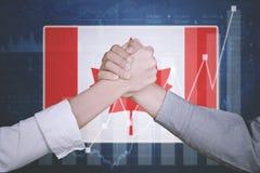Partner biznesowy z Kanada flaga fotografia stock