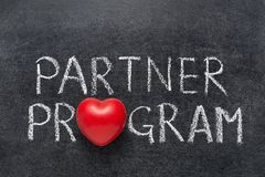 Partner program. Phrase handwritten on blackboard with heart symbol instead of O Royalty Free Stock Image