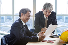 Partner of senior engineering working man serious meeting about Stock Photography