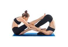 Partner-Yoga lokalisiert auf Weiß lizenzfreies stockbild