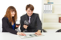 Partners celebrate reception of big income Stock Image