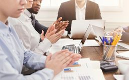 Partners clapping hands after business meeting. Glad partners clapping hands after business meeting or seminar. Professional education, presentation or coaching stock photography
