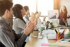 Partners clapping hands after business meeting. Team support. Glad partners clapping hands to colleague making presentation about profit increasing, copy space stock photos