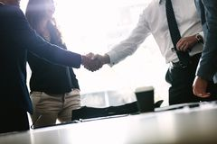 Business men shaking hands with each other after a deal stock image