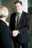 Partners giving a handshake Stock Image