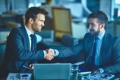 Partners handshaking Stock Images
