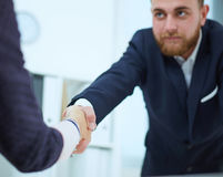 Partners made deal and sealed it with handclasp. Business people shaking hands, finishing up a meeting. Serious business and partnership concept. Partners made Royalty Free Stock Photo