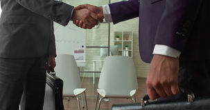 Partners meeting in office and shaking hands Royalty Free Stock Photo