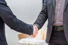 Partners meeting! Two young businessman standing opposite each o stock photo
