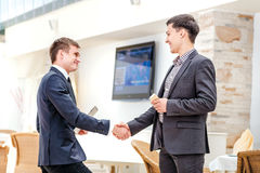 Partners meeting! Two young businessman standing  Royalty Free Stock Images