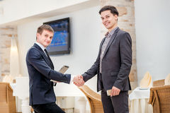 Partners meeting! Two young businessman standing opposite royalty free stock image