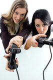 Partners playing game and holding remote Stock Photo