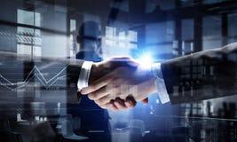 Partners shaking hands . Mixed media Royalty Free Stock Photo