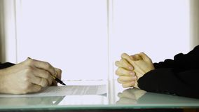 Partners signing contract. Close-up female client hands and male businessman hands with pan.  stock video