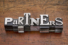 Partners word in metal type Stock Photos