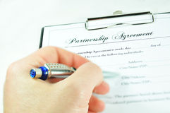 Partnership. Businessman signing a partnership agreement Royalty Free Stock Photo