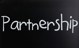 Partnership. The word Partnership handwritten with white chalk on a blackboard Royalty Free Stock Photos