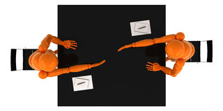 Partnership. Two orange mannequin shaking hands over a desk Royalty Free Stock Photos