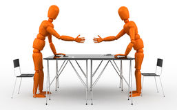 Partnership. Two orange mannequin shaking hands over a desk Royalty Free Stock Photography