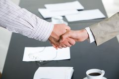 Partnership. Image of successful partnership of people being confirmed by handshake