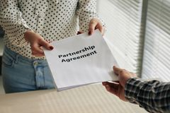 Partnership agreement. Assistant giving partnership agreement to the boss Royalty Free Stock Photos