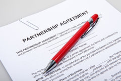 Partnership agreement forms with pen Royalty Free Stock Photo