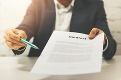 Partnership - businessman giving business contract to sign. Partnership - businessman giving new business contract to sign royalty free stock image