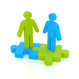 Partnership concept. Business partnership of a couple of stand-up on puzzle pieces Royalty Free Stock Photos