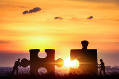 Partnership concept, Businessman puzzle pieces together teamwork. To success Stock Images