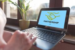 Partnership concept on a laptop screen. Laptop screen displaying a partnership concept Stock Image