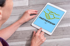 Partnership concept on a tablet. Woman using a tablet showing partnership concept Royalty Free Stock Image