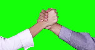Partnership handshake of two business people. Closeup of partnership handshake of two faceless business people in front of green screen background. Shot in 4k stock video