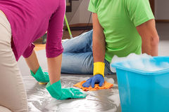 Partnership in housework Stock Photos