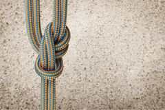 Partnership. Tied knot rope climbing equipment alliance cooperation connection Royalty Free Stock Photo
