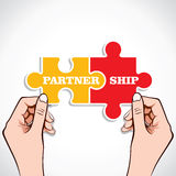 Partnership puzzle piece in hand Stock Photos
