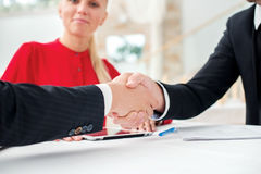 Partnership. Three successful and confident businesspeople shake Royalty Free Stock Photography