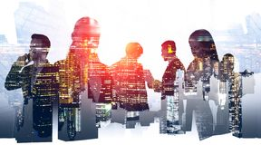 Partnership of young business people, night city royalty free stock photo