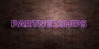 PARTNERSHIPS - fluorescent Neon tube Sign on brickwork - Front view - 3D rendered royalty free stock picture. Can be used for online banner ads and direct Stock Photos