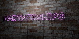 PARTNERSHIPS - Glowing Neon Sign on stonework wall - 3D rendered royalty free stock illustration. Can be used for online banner ads and direct mailers Royalty Free Stock Photography