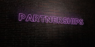 PARTNERSHIPS -Realistic Neon Sign on Brick Wall background - 3D rendered royalty free stock image. Can be used for online banner ads and direct mailers Royalty Free Stock Photography