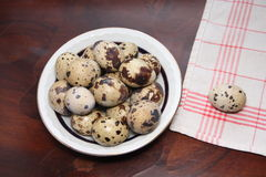 Partridge eggs. On a wooden table royalty free stock photography