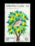 A partridge in a pear tree. Christmas Island - circa 1977: A partridge in a pear tree - part of a set of 12 mail stamps printed on Christmas Island depicting Royalty Free Stock Image