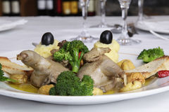 Partridge stuffed with chestnuts. Restaurant dish on restaurant white table - partridge stuffed with chestnuts stock photos