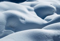 Parts of body. The rounded stone cover snow Royalty Free Stock Photo